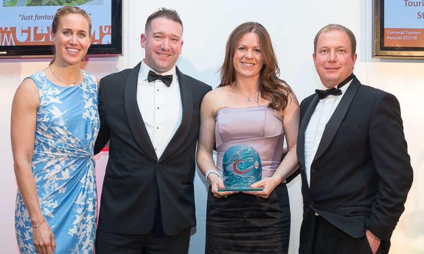 Golden moments: from the left, Olympic rowing superstar Helen Glover and award sponsor Rob Vivian congratulate Becki and Phil Osborne of Polmanter Touring Park on their success in the Cornwall Tourism Awards