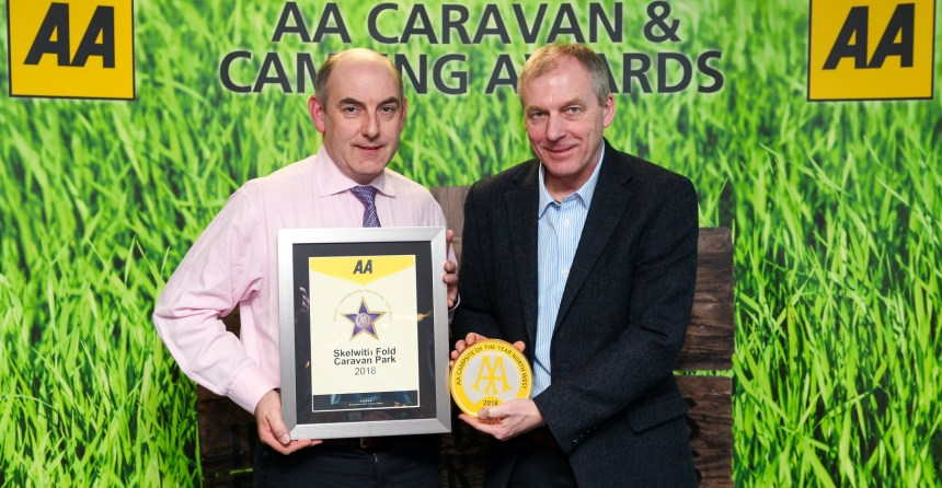 Henry Wild (left) is presented with his park's award by David Hancock, AA Caravan and Camping Coordinator