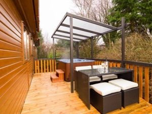 Luxury lodges include timber decking and private hot tubs