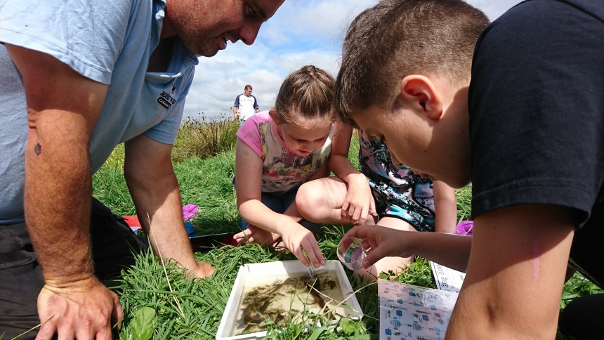 Lucky dip: youngsters examine their catches from Moss Wood's spring-fed lake during the park's open day