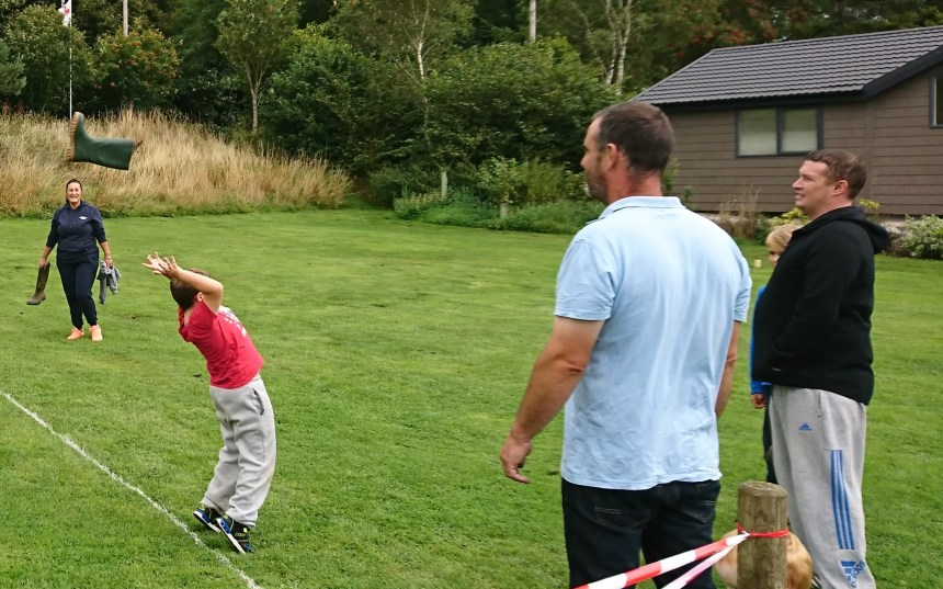 Give it some welly: youngsters and grown-ups did their best to claim the record for the day's longest throw