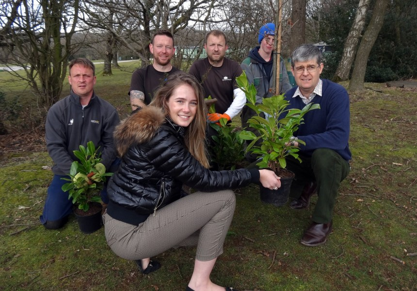 Michael Holgate (right) and some of his Silverdale team make the latest wildlife-friendly plantings on the park