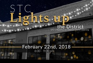 STC Lights Up the District logo for STC's Warehouse District Grand Opening on February 22nd, 2018, from 6:00-9:00 pm.