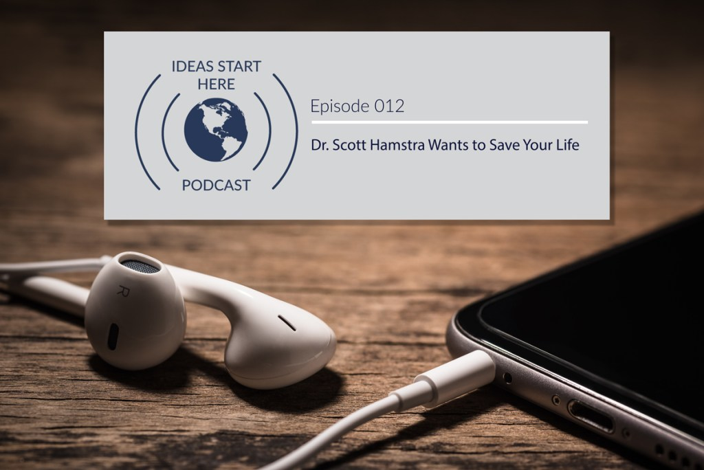 "Earbuds plugged into a smartphone and a sign that says ""Ideas Start Here Podcast Episode 12: Dr. Scott Hamstra Wants to Save Your Life"""