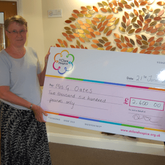Lottery winner with a giant cheque