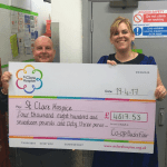 A giant cheque is given to St Clare