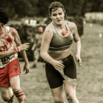 A woman runs from a fake zombie
