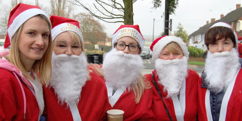 A row of women dressed as Santa