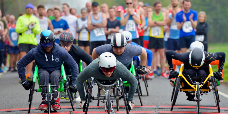 Runners and wheelchair athletes at the start line of the St Clare 10k