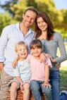 smiling-family-picnicking-in-the-park