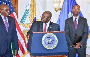 Gov. Kenneth Mapp, center, flanked by IRB Director Marvin Pickering, left, and Attorney General Claude Walker at Wednesday's press conference (Photo provided by Government House)