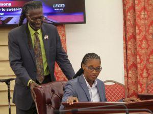 Sen. Positive Nelson helps Sen. Janelle Sarauw into her official seat in the V.I. Legislature.