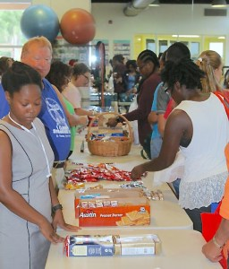 UVI employees browse supply tables set up Thursday at the Wellness Center on the university's St. Thomas campus.