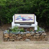 Look for the Villa Madeleine entrance sign on East End Road, just past The Reef golf and disc-golf course.