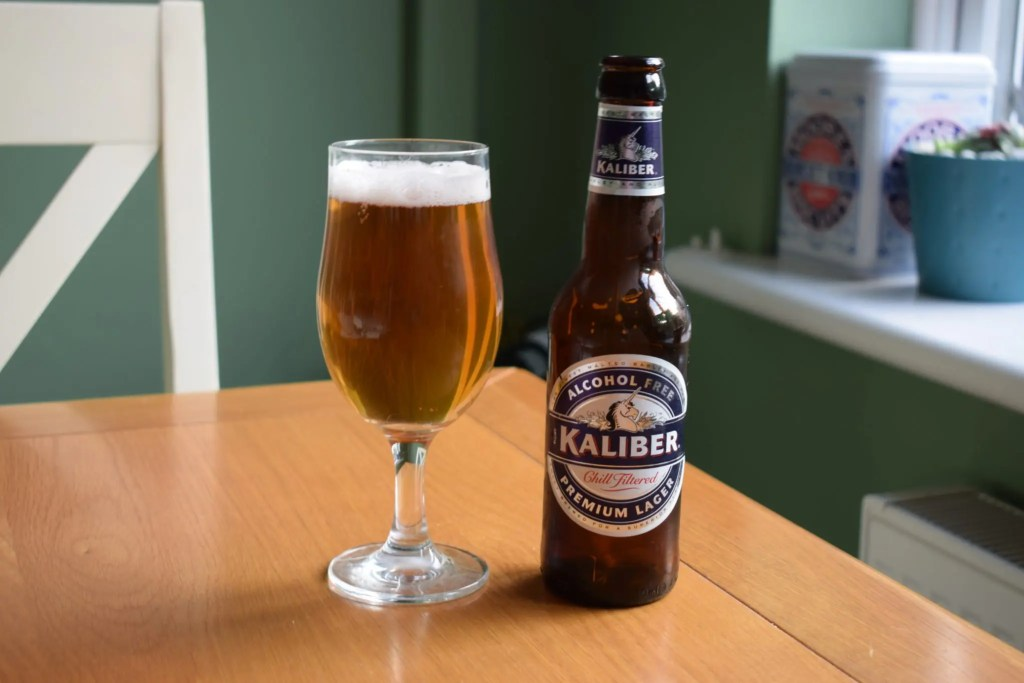 Bottle and glass of Kaliber non-alcoholic beer