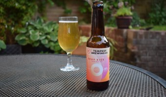 Bottle of Tempest Drop Kick 0.5% with glass in background