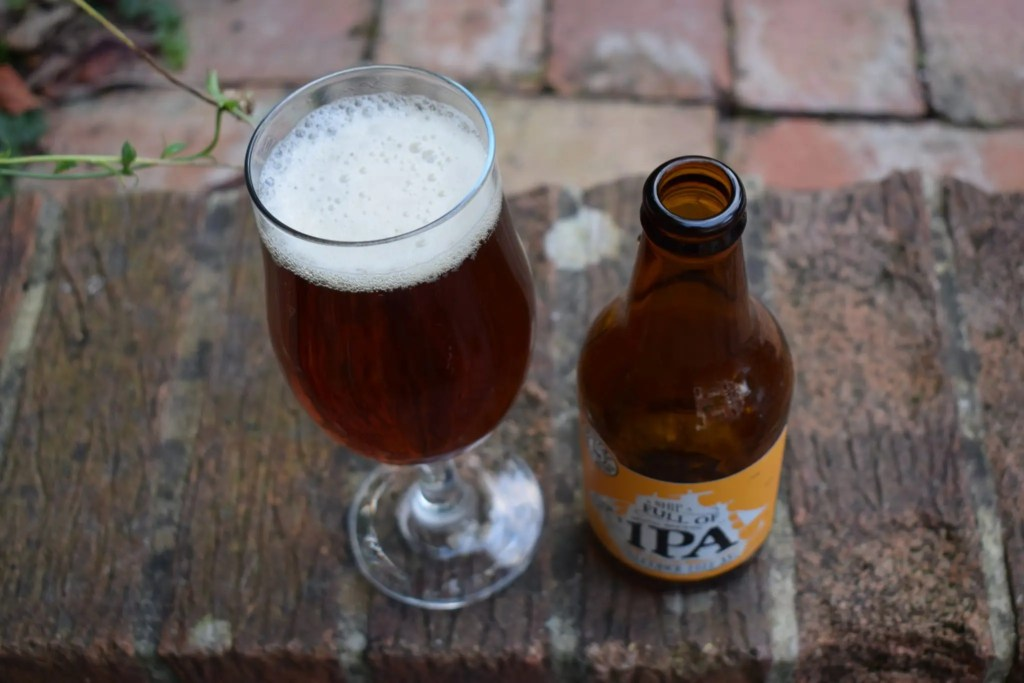Brutal Brewing non-alcoholic Ship Full of IPA bottle and glass