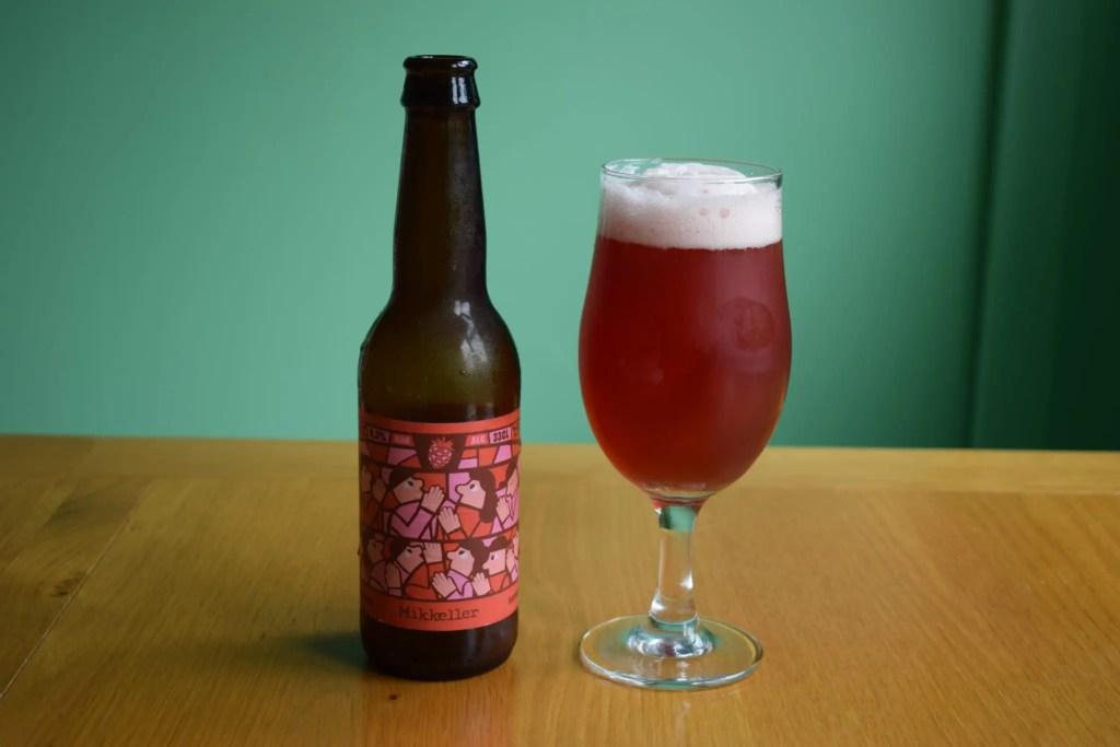 Mikkeller Raspberry Limbo non-alcoholic sour beer - glass and bottle