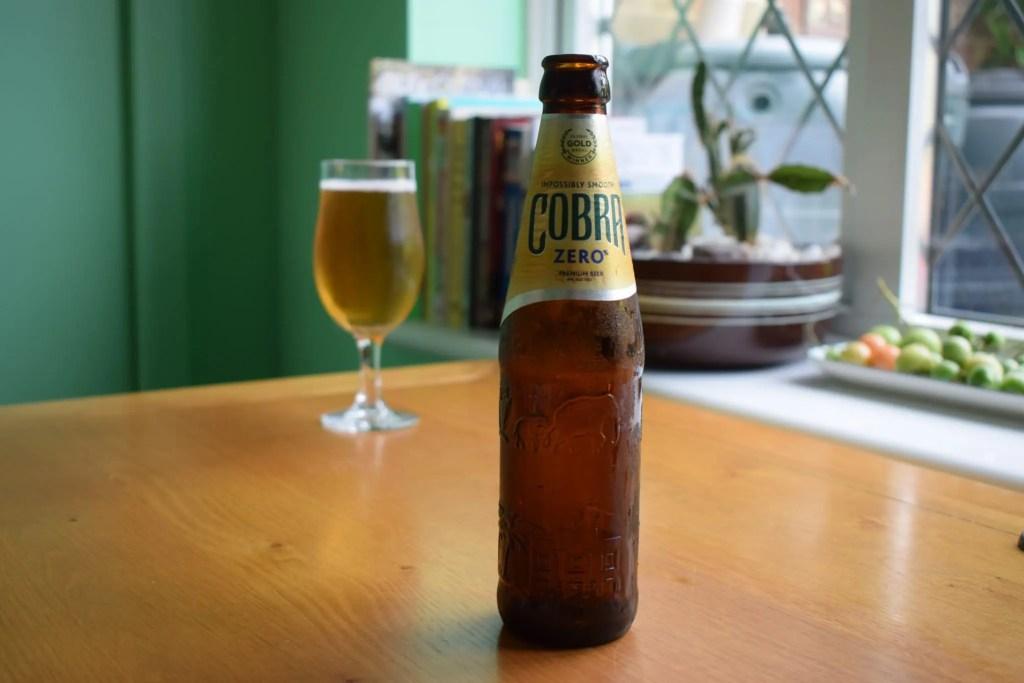 Cobra Zero non-alcoholic lager glass and bottle
