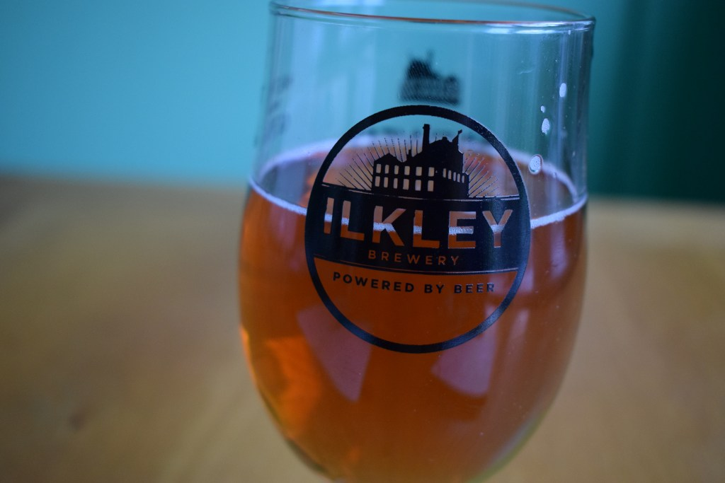 Glass of Ilkley Brewery 'Virgin Mary' non-alcoholic beer