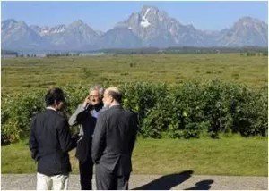 Who's doing the looming -- the central bankers or the Grand Tetons? (photo credit Reuters/Price Chambers)