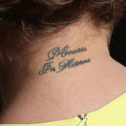 17 celebrity latin tattoos steal her style for Cursive neck tattoos