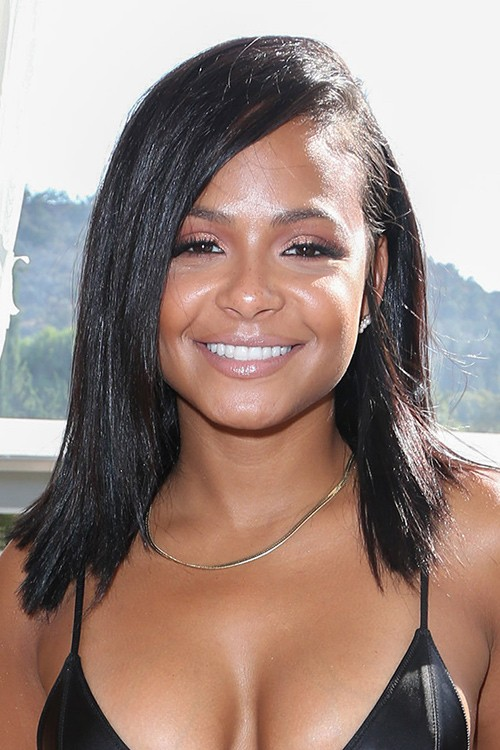 Christina Milians Hairstyles Amp Hair Colors Steal Her Style