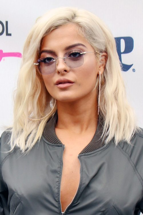 Bebe Rexha Wavy Platinum Blonde Choppy Layers Hairstyle