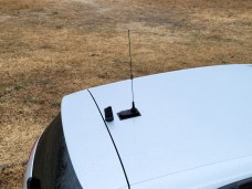 Larsen's NMOHFGPS combination mount and a WeBoost magnetic-mount cellular antenna...