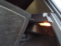 The same clip that supports the rear deck also holds up the floor when in the raised position.