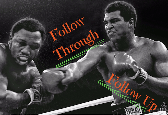 Boxer Muhammed Ali following through with a punch