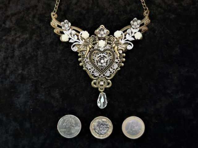 A lovely piece of steampunk jewellery. Handmade bib necklace in silver and bronze colour tones.
