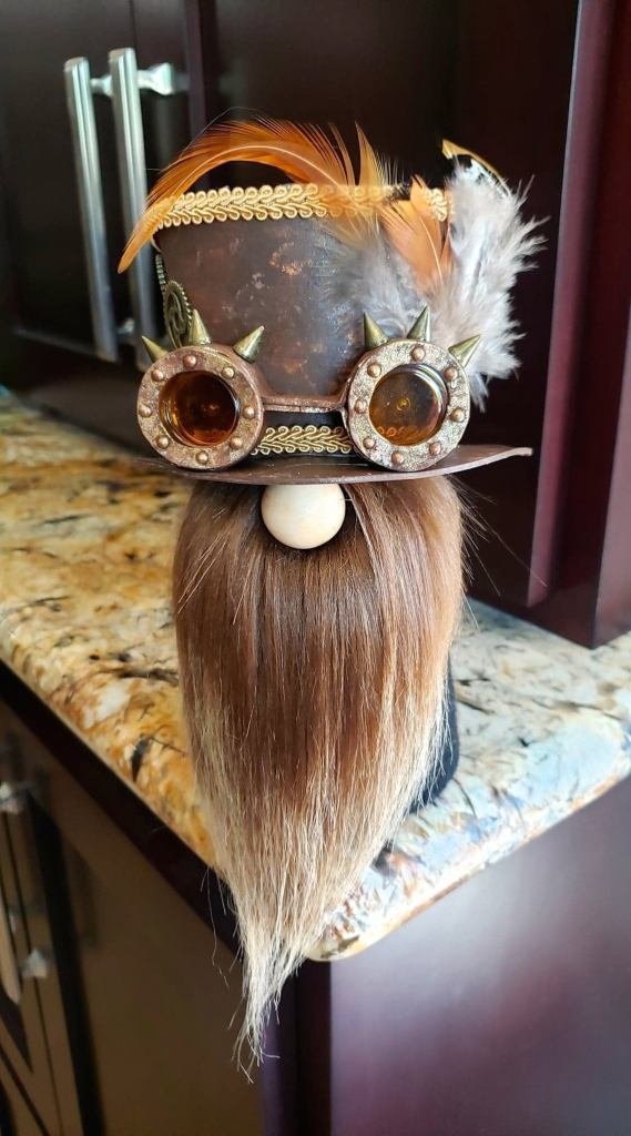 Steampunk Sock Gnome with Brown Top Hat, Brown and Copper Goggles with Orange Lenses and Bronze Spikes, Feathers, Gears and Amber Beard