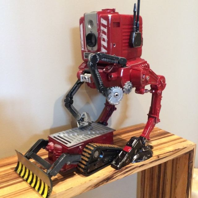 """This duo of Robots scours the wasteland for scrap parts"". Vintage Kodak walker scavenger droid Camera robot Cam-bot kitbash AT-ST chicken walker"