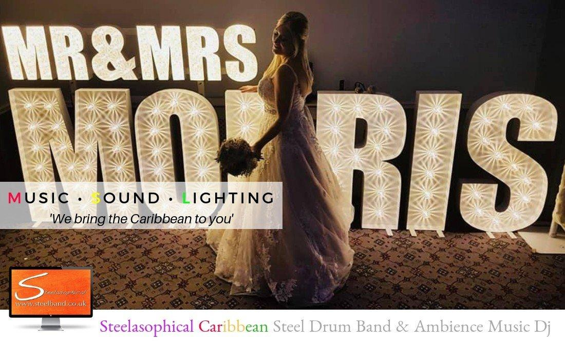 Steelasophical steel Pan Drum Band band DJ Steelpan |Bride stood by LED Letters