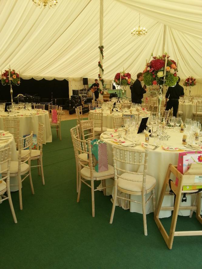 Longstowe Hall | wedding venue Steelasophical Steelpan inside the Marquee. Band and Stage tables and cake