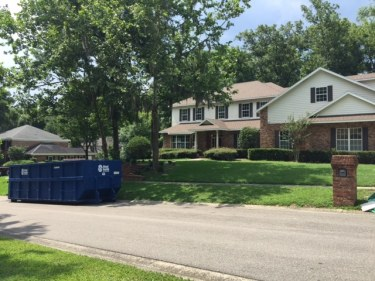 image of a dumpster rental in front of a home remodel project