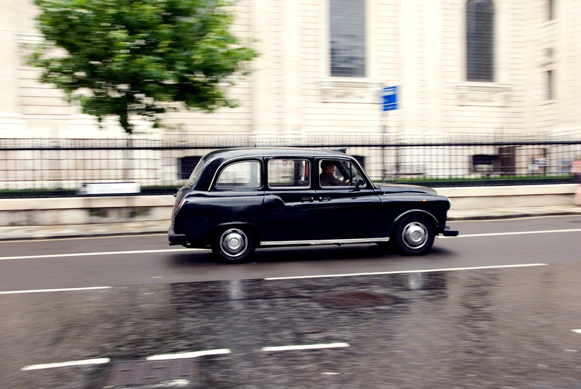London Black Cab Taxi speeding past St Paul's Cathedral