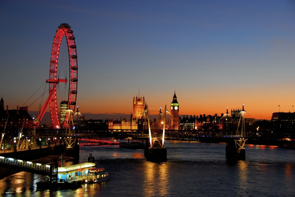 The London Eye in red, and Houses of Parliament at sunset
