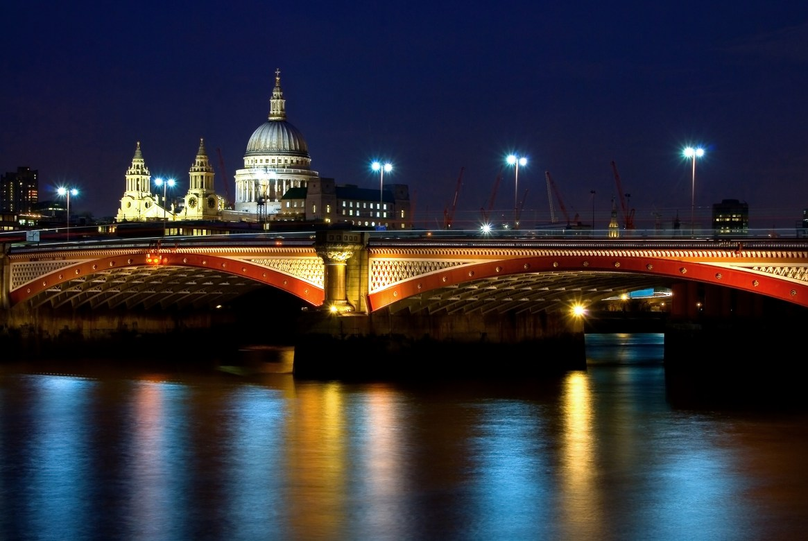 St Paul's and Blackfriars Bridge lit up at night and reflected in the Thames, London