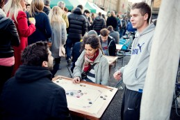 People playing Carrom on Brick Lane