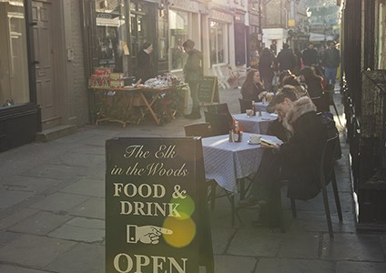 Al fresco diners in Camden Passage on a sunny afternoon