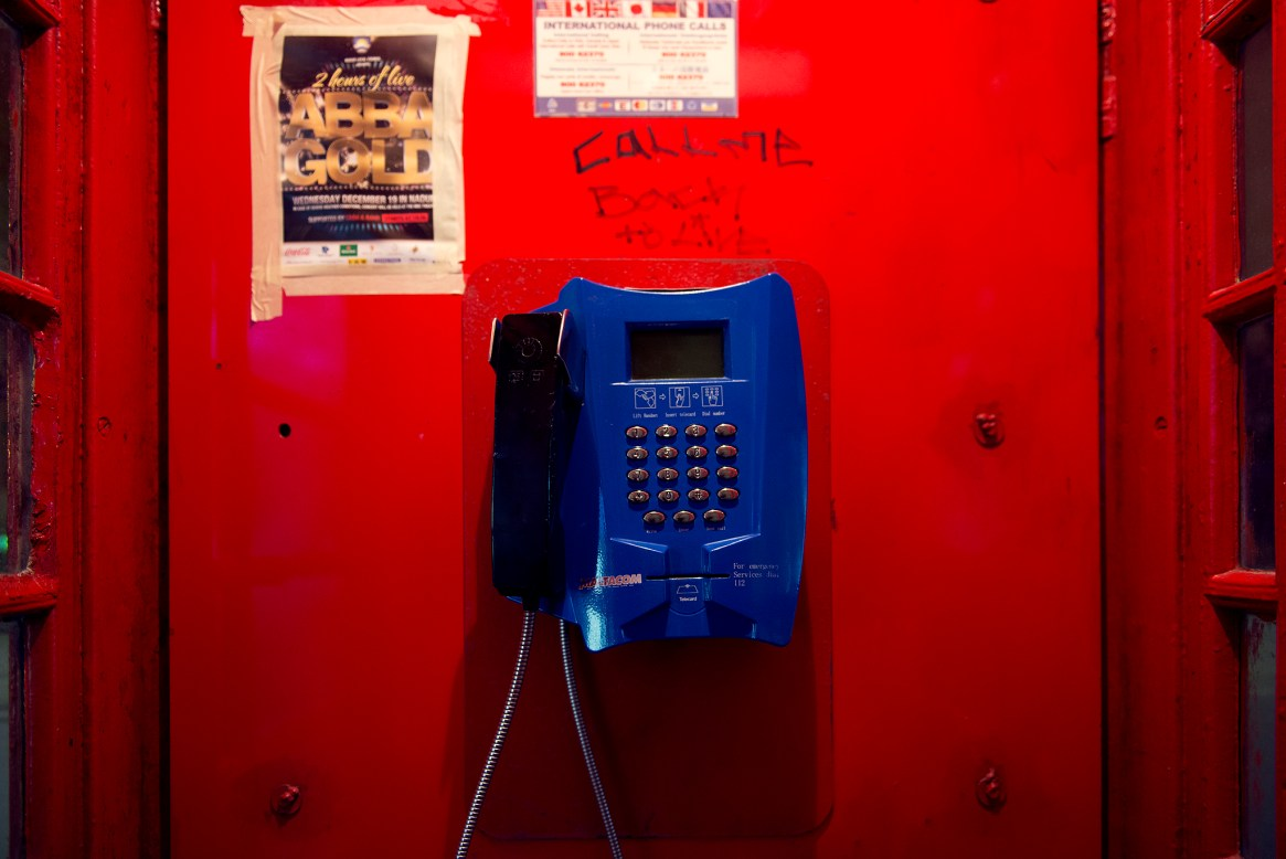 Red phonebox with blue phone