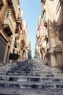 Steep steps and old buildings in Malta's old town