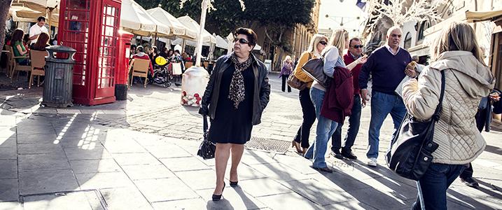 Woman in black walking down the street