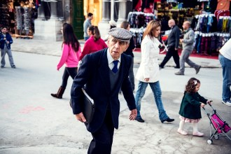 Suited old man with a cap