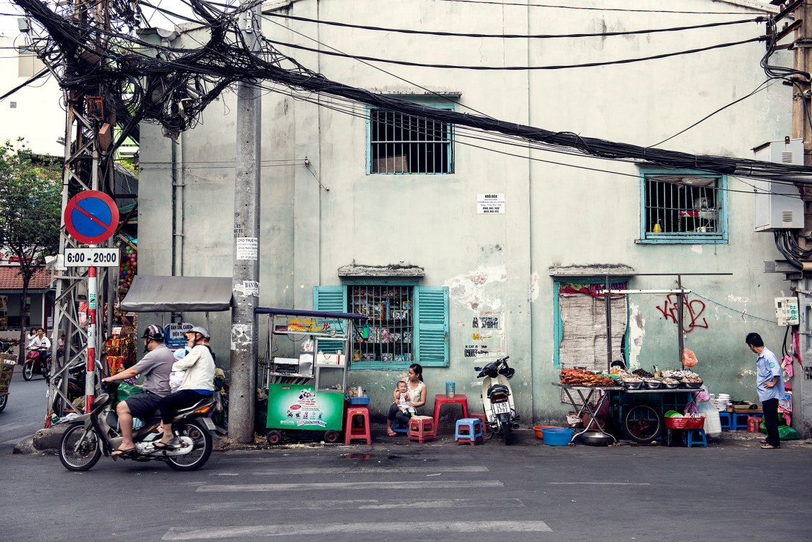 People get ready for dinner time on the street in Ho Chi Minh City