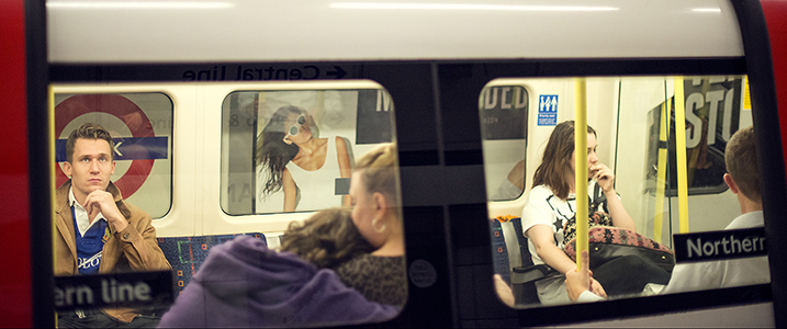 Commuters seen through a Northern Line tube carriage window