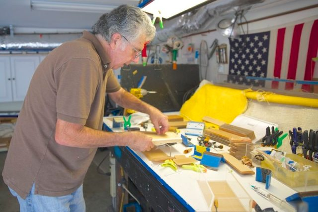 Edward R. Thomas crafting the acrylic clutch collection in the workshop