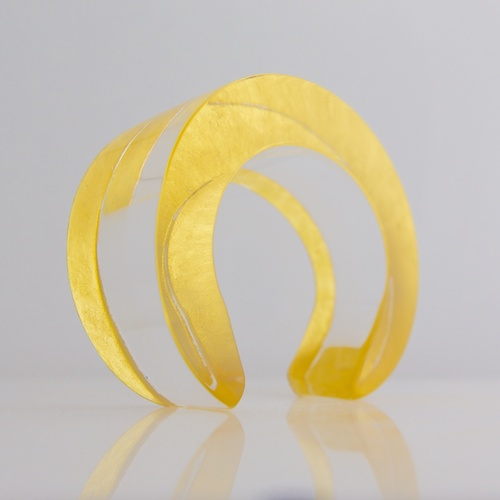ON THE MONEY GOLD AND ACRYLIC CUFF BY STEFANIE PHAN. $280 at stefaniephan.com